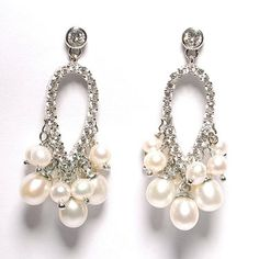These are a supurb pair of earrings set in silver. A teardrop shape studded with cubic zirconia & droplets of fresh water pearls.