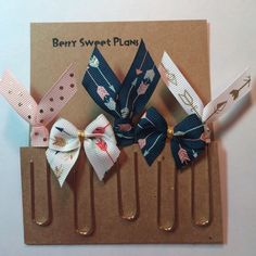 A personal favorite from my Etsy shop https://www.etsy.com/listing/247083136/set-of-5-arrow-ribbon-planner-clips
