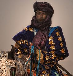 A Nigerian man at the Durbar festival. A Durbar festival is an annual festival celebrated in several cities of Nigeria. It is celebrated at the culmination of Muslim festivals Eid al-Fitr and Eid al-Adha. It begins with prayers, followed by a parade of the Emir and his entourage on horses, accompanied by music players, and ending at the Emir's palace. Durbar festivals are organised in cities such as Kano, Katsina and Bida, and are considered touristattractions.