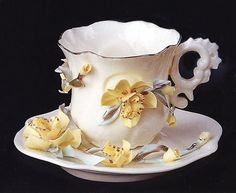 Yellow flowers on demitasse cup and saucer