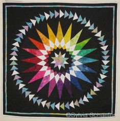 Color Me Clockwise by Sylvia Schaefer: she modified a mariner's compass quilt from Judy Mathieson's book