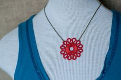 """""""Hill Country Hill Tribers provides supplemental income and marketable skills to artisans in Austin's refugee community."""" ~from http://www.hilltribers.org    Kachin Necklace (Tatted Flower in Poppy and Bronze, by Christine), via Etsy."""
