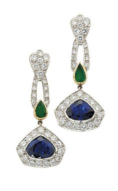 A SAPPHIRE, EMERALD AND DIAMOND SUITE, BY CARTIER   The necklace designed as five pentagonal sapphire and diamond clusters with drop-shaped emerald spacers to the diamond backchain, suspending a sapphire and diamond drop-shaped pendant, with bracelet and ear pendants en suite, necklace 37.0 cm, bracelet 17.0 cm, ear pendants 3.5 cm long  Signed Cartier, Nos. R3068, R3070 and R3069