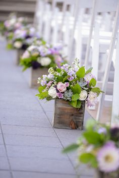 Love the flower boxes down the aisle at this outdoor ceremony in Epcot