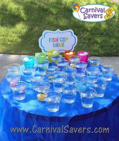 DIY - Fish Cup Carnival Game Could use playdoh to secure the plastic fish inside the cup, fill with water, use ping pong balls!!! Easy, quick and fun!!!