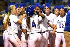Teammates mobbed Kelsey Stewart at home plate after she scored the winning run. (Photo: Jim Burgess)