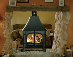 Double Sided Wood Burning Stove.   This is what I want to replace my fireplace with.