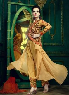 Cream Georgette Party wear sakwar kameez with Art Silk embroidered jacket, Approx top length 53 to 54 inches. Kameez with chiffon dupatta & satoom buttom.
