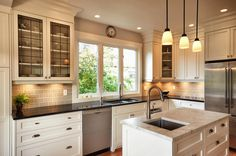 Custom white painted kitchen cabinets. Built & installed by James Weedmark of J Weedmark Millwork