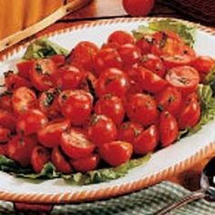 Herbed Cherry Tomatoes Recipe -<B>Meet the Cook:</B> My recipe's a good one for when you want a little fancier salad dish but one that's still quick to fix. I find it's especially popular served with grilled steak, baked potatoes and corn on the cob. I came across Herbed Cherry Tomatoes when I was a new bride searching for interesting ways that I could cook for my husband. Jerry and I now have a pair of daughters, ages 16 and 10. -Dianne Bahn, Yankton, South Dakota