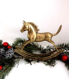 Hey, I found this really awesome Etsy listing at https://www.etsy.com/listing/473098714/rocking-horse-figurine-vintage-brass