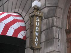 A wonderful vintage lantern-like sign still lights the way at the entrance to the Fulton Street IRT station downtown. Metro Subway, Nyc Subway, Nyc Pics, Fulton Street, Vintage Lanterns, Sign Writing, Sign Materials, Metro Station, Manhattan