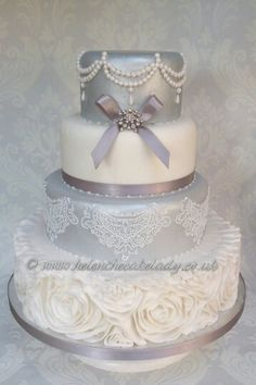 Beautiful silver and white 4 tier wedding cake with rose ruffle ...
