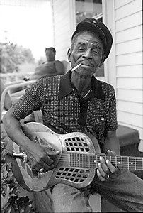 John Dee Holeman (born April 4,1929) is a Piedmont blues guitarist, singer, and songwriter. His music includes elements of Texas blues, R & B and jazz. In his younger days he was also known for his proficiency as a 'buckdancer'.
