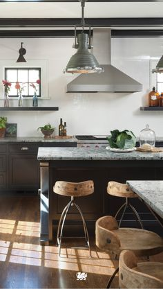 Embrace the rustic look of the modern farmhouse with tastefully unfinished wooden stools balanced by a smooth countertop design like Praa Sands™.