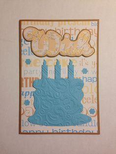 """WISH"" with embossed cake on birthday paper on kraft handmade card."
