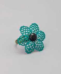 Vintage flair meets on-trend charm in this statement ring, which features an ornate metal flower blooming with hand-painted style. Adjustable bandFace: 1'' W x 1'' LBrass / bronzeMade in the USA