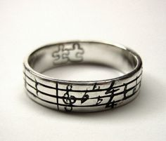A ring custom engraved with the notes to your favorite song. I. Would. Love. This.