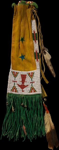 Arapaho pipe bag  ca. 1885  Wyoming or Oklahoma  Deer hide, pigment, glass beads, feathers, brass bells