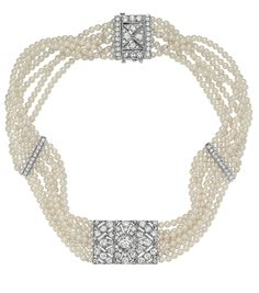 A Cultured Pearl and Diamond Choker Necklace, designed as seven rows of cultured pearls, joined by an open-work geometric plaque of rectangu...