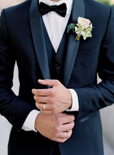 besame wedding styled shoot groom with a butterfly in a black suit with a waistcoat and a buttonhole of roses on his finger a simple gold ring carrie king photographer wedding groom attire Tuscan Inspired Wedding Style Shoot Wedding Groom, Wedding Men, Wedding Attire, Wedding Styles, Wedding Ideas, Men Wedding Fashion, Mens Wedding Style, Wedding Ceremony, Wedding Castle