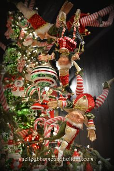 Decorating with Christmas elves Hanging from the ceiling beside the Christmas tree are our 13.5 inch Jester Hat Elf and 14.5 inch Christmas Pointy Hat Elf find elves in this photo at shelleybhomeandholiday.com