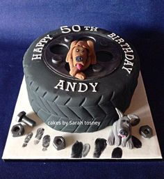 Tyre cake for a mechanic , with replicas of his Great Dane ornaments made out of fondant