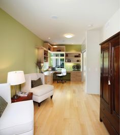 maple floor with white sofa and green wall