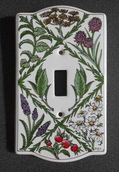 "Vintage Santa Barbara Ceramic Design Single Switch Plate Cover $5 Vintage Ceramic Garden Themed Light Switch Plate, 1994 This is a lovely ceramic single light switch plate by Santa Barbara Ceramic Design. The design shows all your favorite garden herbs including: Dill, Clover, Sage, Rosemary, Lavender, Chamomile In lovely condition, no chips, cracks, crazing, etc. Also marked on the front lower right hand side ""© SBCD '94 LLB"". Sorry, I don't have mounting screws, but you can easily buy repl"