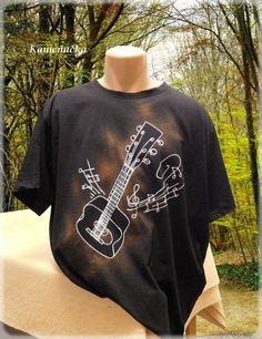 pánské+tričko+s+kytarou+a+notami+Pánské+triko+z+čisté+bavlny,+černé.+Velikost:XS+až+XXXXL+Triko+je+kvalitní+vysoké+gramáže,+při+praní+se+nedeformuje.+Dle+vašeho+přání+vyrobím+i+jiný+hudební+nástroj.+V+nabídce+mám+i+dámská+a+dětská+trička+!!!+Každý+kus+originál+:-)