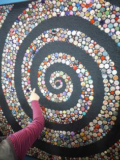 ButtonArtMuseum.com - Tokyo Quilt Festival 2013 by Saké Puppets, via Flickr.  The circles are made of kimono silks.