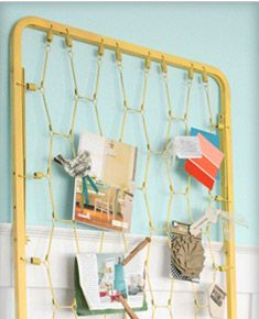 From crib box spring to photo holder...just add a splash of spray paint!