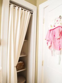 Remove door of closet in small space and replace with curtain for easy access.