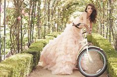 Beautiful dress - no sure how's she's riding with it though!