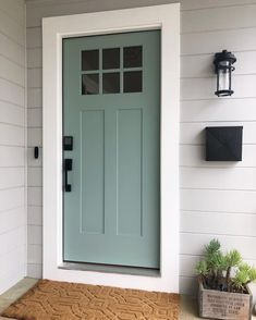 17 curb appeal ideas that will entice homebuyers - Modern Front Door Paint Colors, Painted Front Doors, Front Door Design, Dark Front Door, Outside House Paint Colors, Teal Front Doors, Front Door Plants, Best Front Door Colors, House Front Door