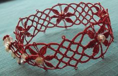 Bobbin lace in enamelled copper wire.  A pattern from the 1600s made into a bracelet