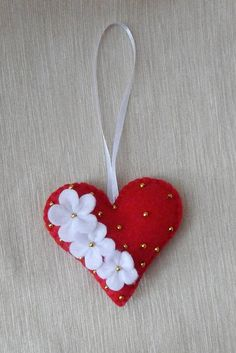 Felt heart ornament. Valentines Day Ornament. Valentines Day Decor. Ornament one side are embroidered with flowers and beads. The decor will look great as Valentines Day Decor, Christmas decoration, Easter tree decorations, as well as room, holiday table and door decorations. Children