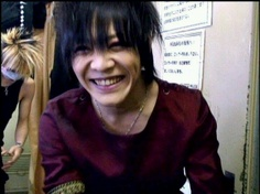 Reita. Kai. The GazettE. Kai looking so adorable with his baby smile, but what is Reita doing in the back? Is he changing?