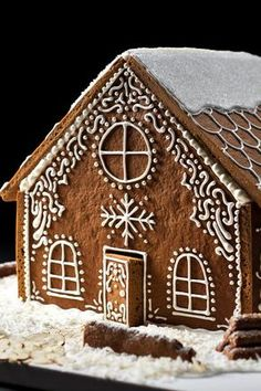 NYT Cooking: To the modern cook, making a gingerbread house may seem nearly as daunting as building a real house. But, like dyeing Easter eggs, it's. Christmas Desserts, Christmas Treats, Christmas Baking, Christmas Cookies, Christmas Time, Christmas Decorations, White Christmas, Xmas, White Gingerbread House