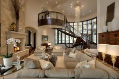 2-story Formal Living Room open to Foyer with floating staircase