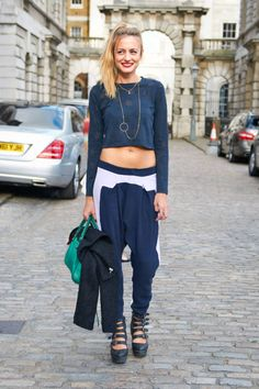 Model Lucy Holt flashes some stomach while photographed at London Fashion Week
