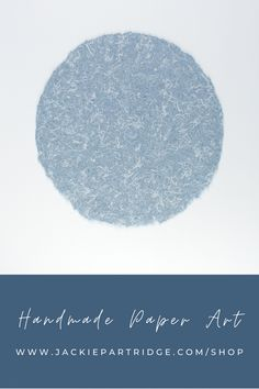 Handmade paper art for your home by artist Jackie Partridge. Handmade denim circular paper ships unframed. Choose a frame to match your style and hang this grogeous minimal art in your home. Art for the walls perfect for a beach house or minimal style.#handmadepaper #jackiepartridge #handmadepaperart Click the link to save 15% on artwork now!