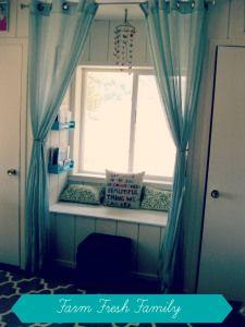 Window seat in a little girl's room.