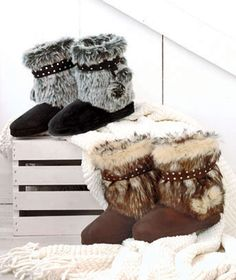 Warm your soles in style with the super comfy and plush microsuede Faux Fur Boot Slippers. Lined with toasty faux shearling fleece, they're the perfect way to pamper yourself after a long day. The durable soles mean you can wear them outside to get t
