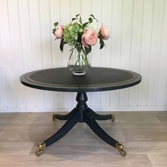 A beautifully elegant regency table painted in a dark gun metal grey. The brass feet with casters have been shone back to life, perfectly complemented by the intricate gold tooling detail on the new handcrafted premium soft black leather hide. Finished with a dark furniture wax this unique piece will create a show stopping centre table for a little bing area or large hallway. Dimensions 89cm diameter and 64cm height. | Shop this product here: http://spreesy.com/BellaAndBudHome/4 | Shop all…