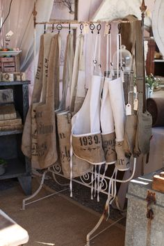 burlap aprons, cute display, not the same old hanger action