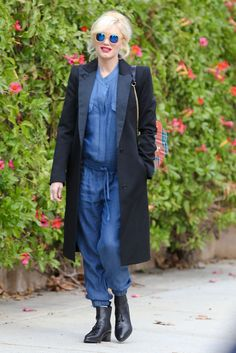 She might've been pushing the envelope with her denim jumpsuit, but that Smythe coat was all business! The ...