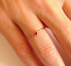 Thin ruby engagement ring in 14k solid gold. Product details: - 14k solid gold - triangle ruby (3x3x3mm) - Band Width: 1mm - Finish: polished ** Can be made in YELLOW, WHITE or ROSE 14 kt gold. Thanks, Roman