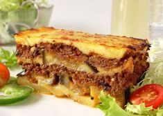 My take on traditional moussaka. The beauty of this recipe (besides great taste) is its ability to freeze (and defrost) so well, with no loss of flavour, making it ideal for OAMC (once a month cooking). Note: Greeks do not eat their food piping hot out of the oven - especially in the summer heat. Food is served just warm or at room temperature (but cooked that day - otherwise it is reheated to freshen it). Flavour is more pronounced at this temperature.