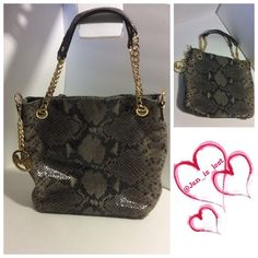 """Michael Michael Kors Python Tote Gorgeous Michael Michael Kors Python tote with gold-tone hardware.  Light wear no pen marks or stains.  Used a handful of times.  Strap drop is 6"""" purse measures 10"""" tall, 11 3/4"""" wide and 3"""" deep. MICHAEL Michael Kors Bags Totes"""